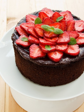 Homemade chocolate cake with strawberry and mint. Shallow dof.