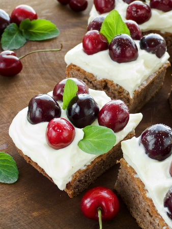 sour cream: Cake with sweet cherries and whipped sour cream. Shallow dof. Stock Photo