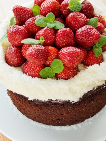 Homemade chocolate cake with strawberry, cream and mint. Shallow dof.