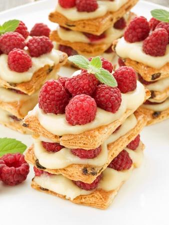 mille: Raspberry mille feuille with custard. Shallow dof. Stock Photo