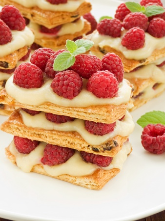mille: Raspberry mille feuille with custard. Shallow dof. Stock Photo