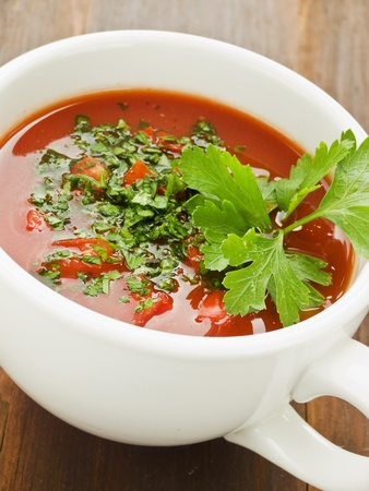 Cup with fresh tomato gazpacho. Shallow dof. photo