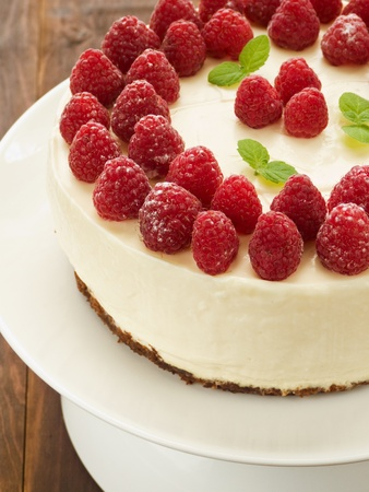 Sour cream cheesecake with raspberries. Viewed from above.