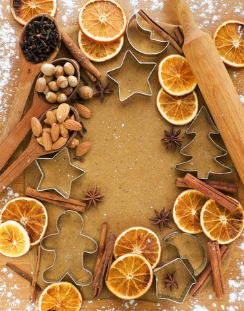star anise christmas: Christmas baking background dough, cookie cutters, spices and nuts. Viewed from above.