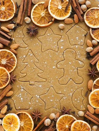 cookie cutters: Christmas baking background dough, cookie cutters, spices and nuts. Viewed from above.
