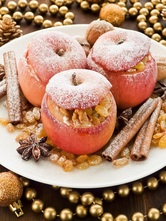 baked treat: Baked apples with raisin, cottage cheese and walnuts. Shallow dof.