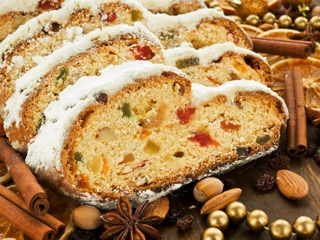 christmas food: Traditional homemade stollen with dried fruits and nuts. Shallow dof.