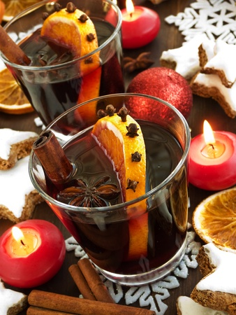 Mulled wine with spices and cinnamon cookies. Shallow dof. photo