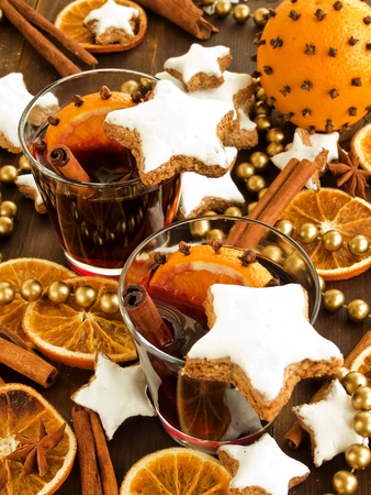 warm drink: Mulled wine with spices and cinnamon cookies. Shallow dof.