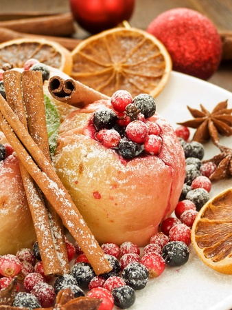 Baked apples with wild berries and spices. Shallow dof. photo