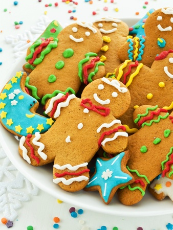 Homemade gingerbread cookies with colored icing. Shallow dof. photo
