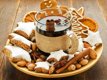 Mulled wine with spices and christmas cookies. Shallow dof. Stock Photo - 11208939