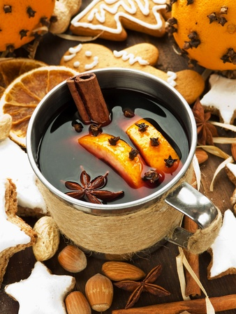 Mulled wine with spices and christmas cookies. Shallow dof. photo
