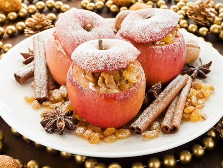 Baked apples with raisin, cottage cheese and walnuts. Shallow dof.