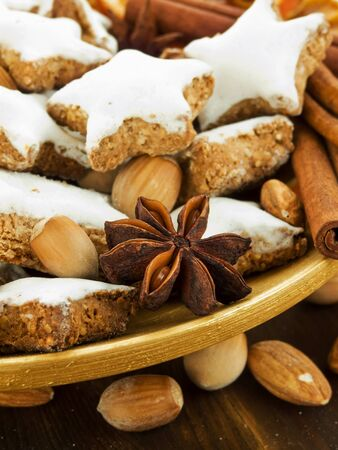 Plate with traditional christmas cinnamon cookies Zimtsterne. Shallow dof. photo