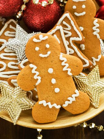 Traditional gingerbread cookies on the wooden plate. Shallow dof. photo