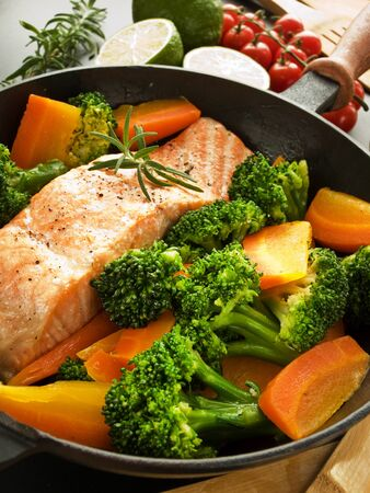 Frying pan with salmon steak, stir-fry veggies and herbs, Shallow dof. Stock Photo - 12433548