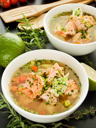 water thyme: Bowls with salmon soup and veggies. Shallow dof. Stock Photo