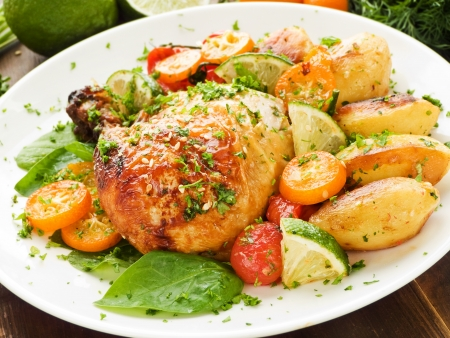 Roasted chicken with stir-fry vegetables, fruits and herbs photo