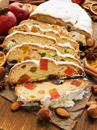 Traditional homemade stollen with dried fruits and nuts. Shallow dof. photo