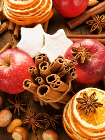 Christmas background made of nuts, fruits and spices. Viewed from above. photo