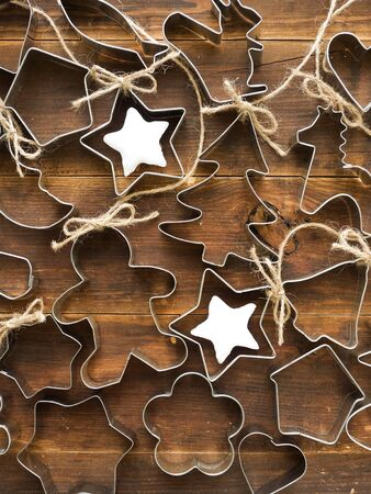 Christmas background made of cookie cutters. Viewed from above. photo