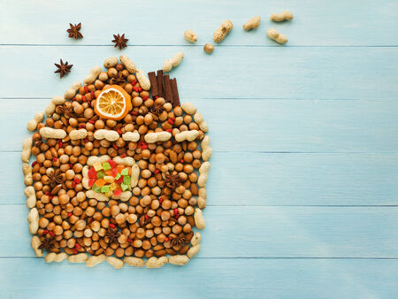 christmas scent: Christmas house made of nuts, berries and anise. Viewed from above.