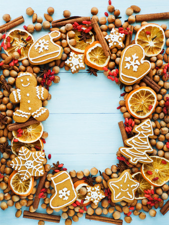 Christmas background made of nuts, dried oranges, and spices. Viewed from above. photo