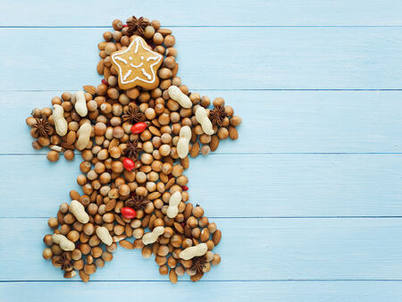 man nuts: Christmas man made of nuts, berries and anise. Viewed from above.