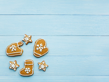 Christmas gingerbread cookies on the blue background. photo