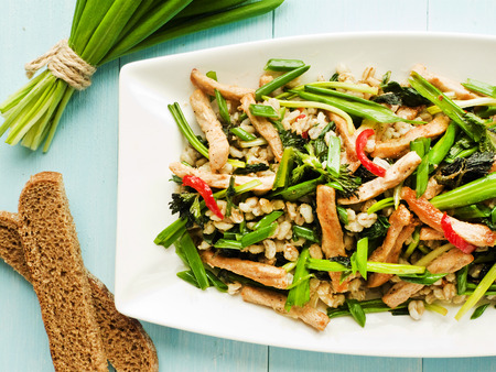 barley seeds: Warm salad with meat, pearl barley and greens. Shallow dof. Stock Photo