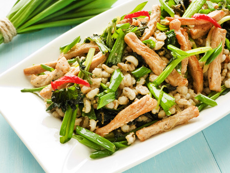 pearl barley: Warm salad with meat, pearl barley and greens. Shallow dof. Stock Photo