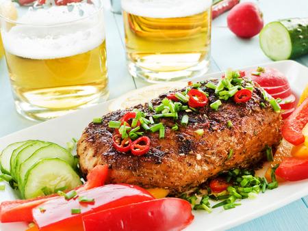 argentinian: Argentinian Asado pork fillet with herbs, veggies and sauce. Shallow dof. Stock Photo