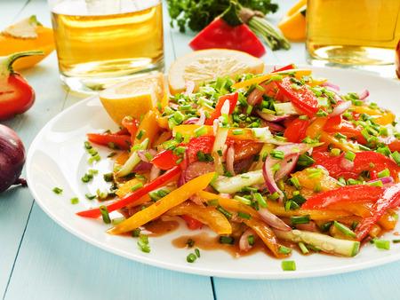 spanish onion: Spring salad with bell pepper, spanish onion, leek and blackberry vinegar. Shallow dof.