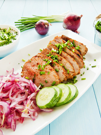 argentinian: Argentinian Asado pork fillet with pickled onions. Shallow dof. Stock Photo