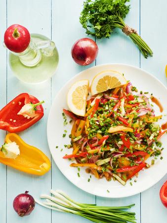 spanish onion: Spring salad with bell pepper spanish onion leek and blackberry vinegar. Shallow dof.