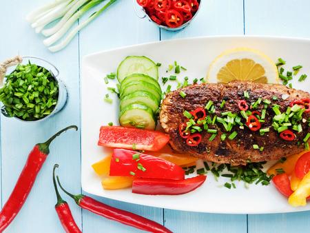 argentinian: Argentinian Asado pork fillet with herbs veggies and sauce. Shallow dof.