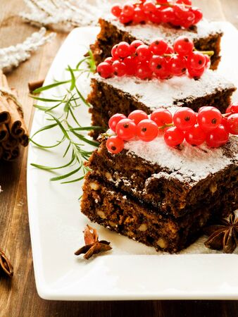 sour cream: Christmas brownies with whipped sweet sour cream. Shallow dof.