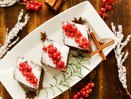 sweet and sour: Christmas brownies with whipped sweet sour cream. Shallow dof.