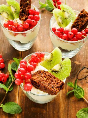 parfait: Glasses with sweet parfait dessert. Shallow dof.