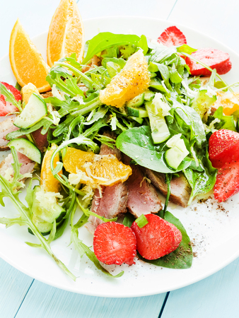 Salad with fruits, herbs and duck fillet. Shallow dof.