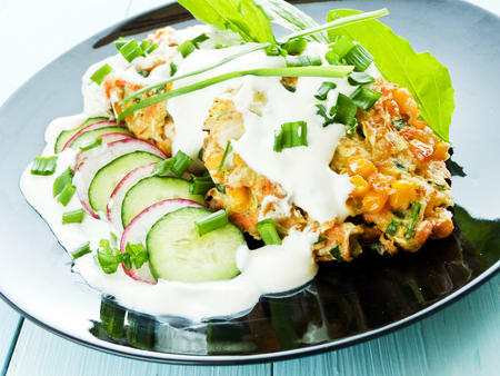 finocchio: Cutlets with cabbage, sweet corn and yogurt sauce. Shallow dof.