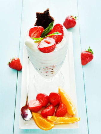 shallow dof: Ice cream, brownie and fruits dessert. Shallow dof. Stock Photo