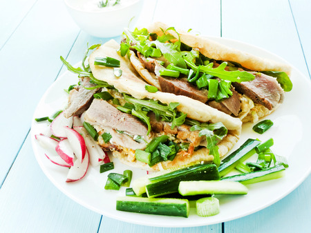 Pitas with duck fillet, herbs and sauce. Shallow dof. Stock Photo