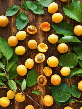 Sweet apricots on the wooden background. Shallow dof.