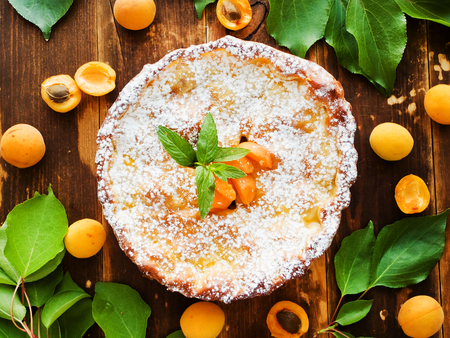 Fresh baked apricot pie with mint. Shallow dof. Stock Photo