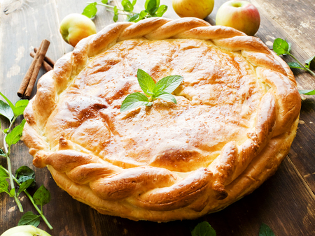 Fresh baked apple pie with cinnamon and mint. Shallow dof. Stock Photo
