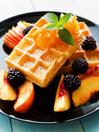 Belgium waffles with fruits, berries and honey. Shallow dof.