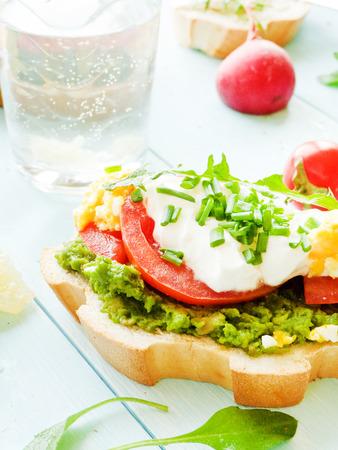 Toast with avocado and egg. Shallow dof.