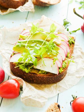 Toast with avocado and raddish. Shallow dof.